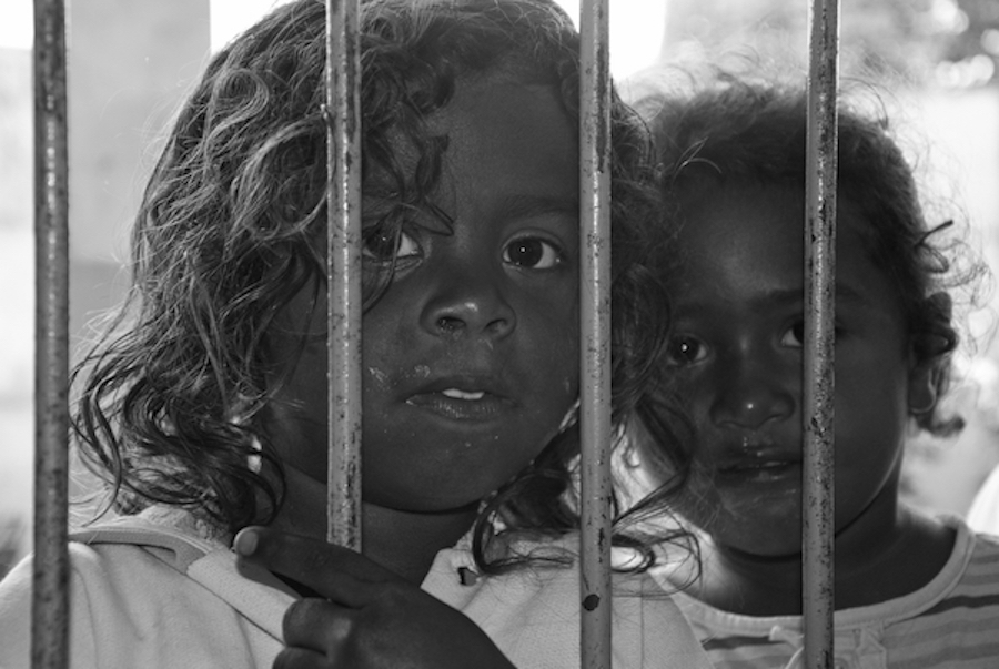young girls behind bars black and white